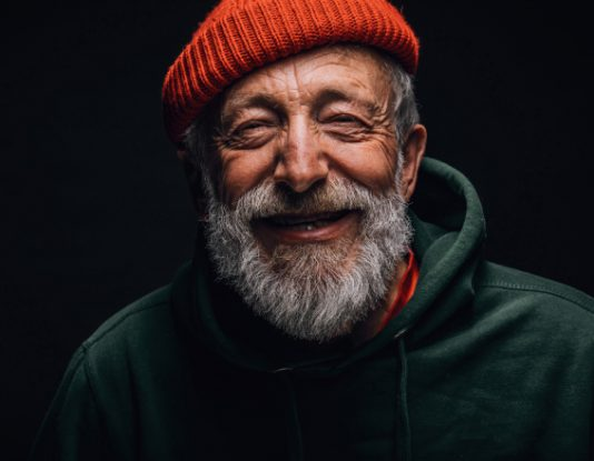 close up of homeless man smiling