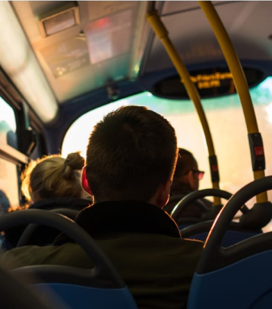 back view of people sitting on a bus