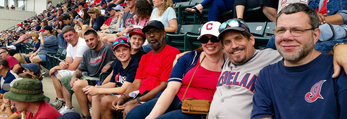 group of people at the indians game smiling for portrait